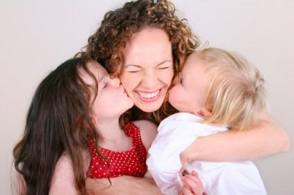 2 kids hug mom