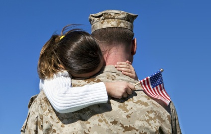 girl hugging soldier