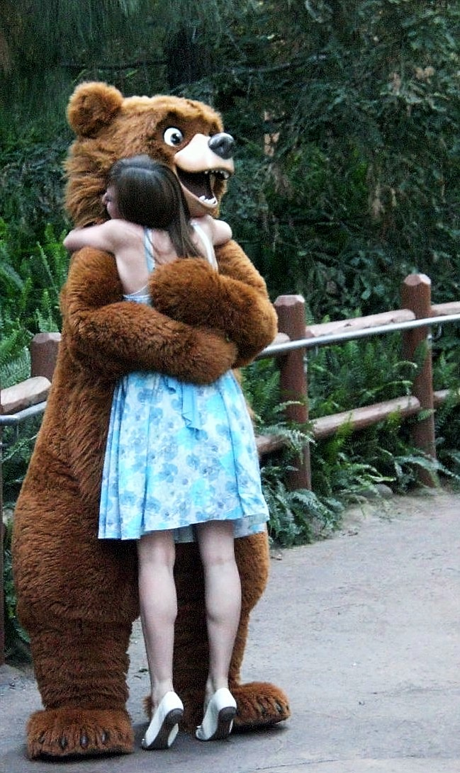Girl hugging bear