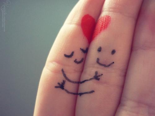 hugs painted on fingers