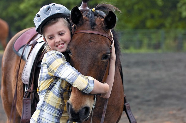 Girl hugging a horse