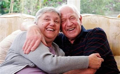 older couple hug