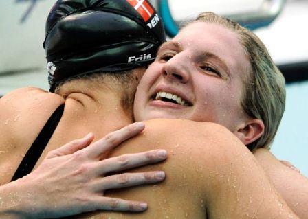 swimmers hug